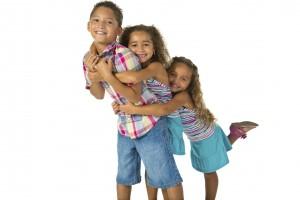Image_three siblings hugging