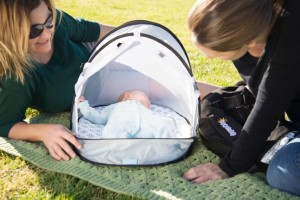 equiptbaby bassinet with family outside