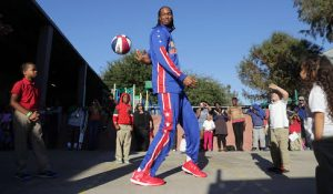 7-foot-4 Harlem Globetrotter Stretch Middleton shows off his ball handling skills at the Star for Hope Women & Family Emergency Shelter, Tuesday, Jan. 20, 2015, in Houston. (AP Photo/Houston Chronicle, Billy Smith II) ORG XMIT: TXHOU103