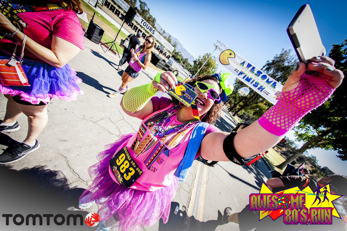 Runners participating at the Awesome 80s Run 5k in Pasadena, California on 8/17/14